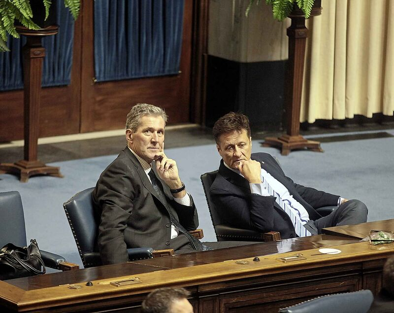 Preimer Brian Pallister and Schuler chat in legislature in 2016 shortly before the election in which the PCs would win and form government. The Tories cried foul over the then-governing NDP's aborted attempt to buy $5 million worth of Tiger Dams.