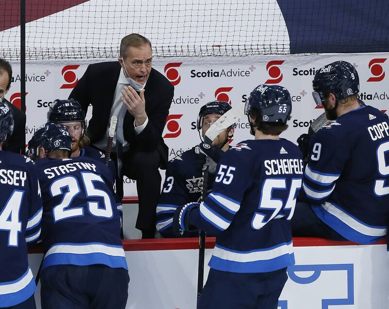 Paul Maurice talks to his team during a time out in the third period against the Edmonton Oilers. THE CANADIAN PRESS FILES/John Woods