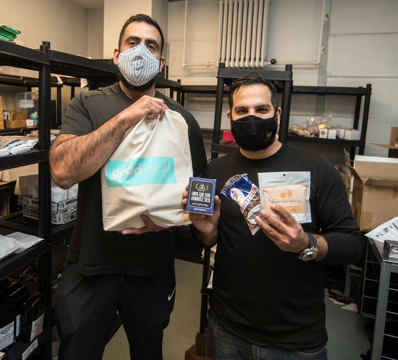 Obby Khan (left) said he and his partner Ali Esmail (right) were working up to 20 hours a day to keep up with orders.