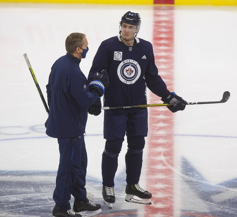Maurice chats with Jets' winger Kristian Vesalainen during a practice in January.