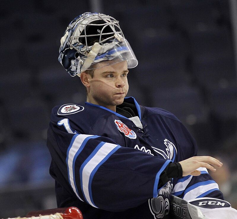 Comrie is quietly putting together the finest season of his career, now 15-11-2 with a .923 save percentage, which is third-best in the AHL.  (Phil Hossack / Winnipeg Free Press files)</p>