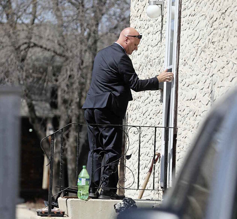 Investigator with the Winnipeg Police Service outside the home of a witness to the fatal altercation which took place on Sunday afternoon.