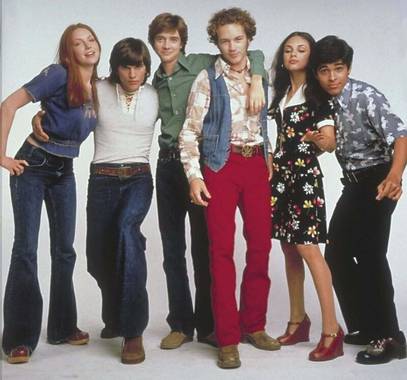 The gang from That '70s Show pass a highway sign featuring 'Winnepeg'. Close enough.