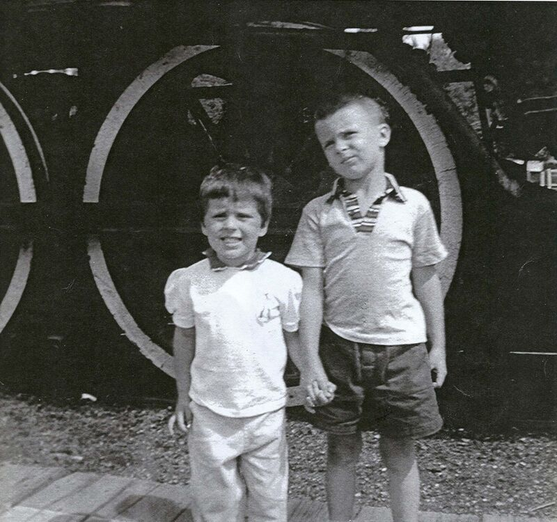 PAUL NEWSOME</p><p>Newsome with his late sister Cathy next to one of the trains that had arrived at Victoria Beach in July 1957.</p></p>