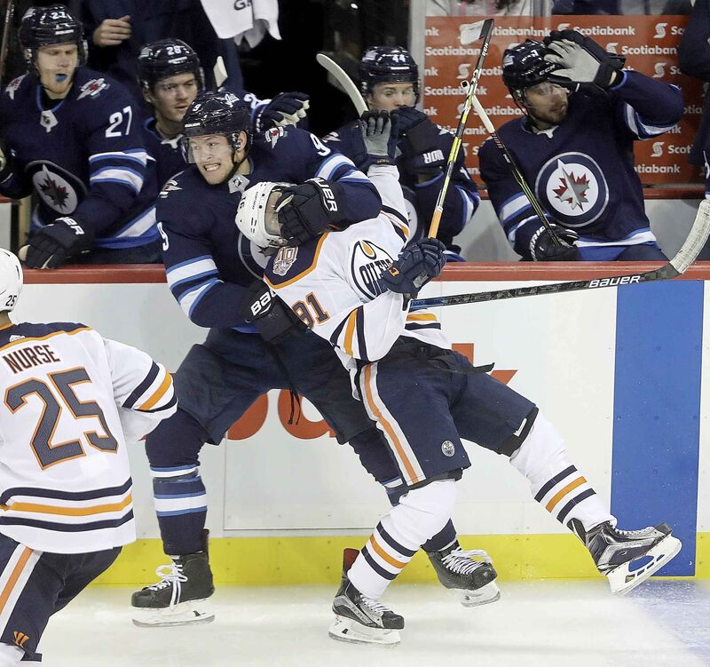 Winnipeg Jets' Andrew Copp throws Edmonton Oilers' Drake Caggiula to the ice during third period.