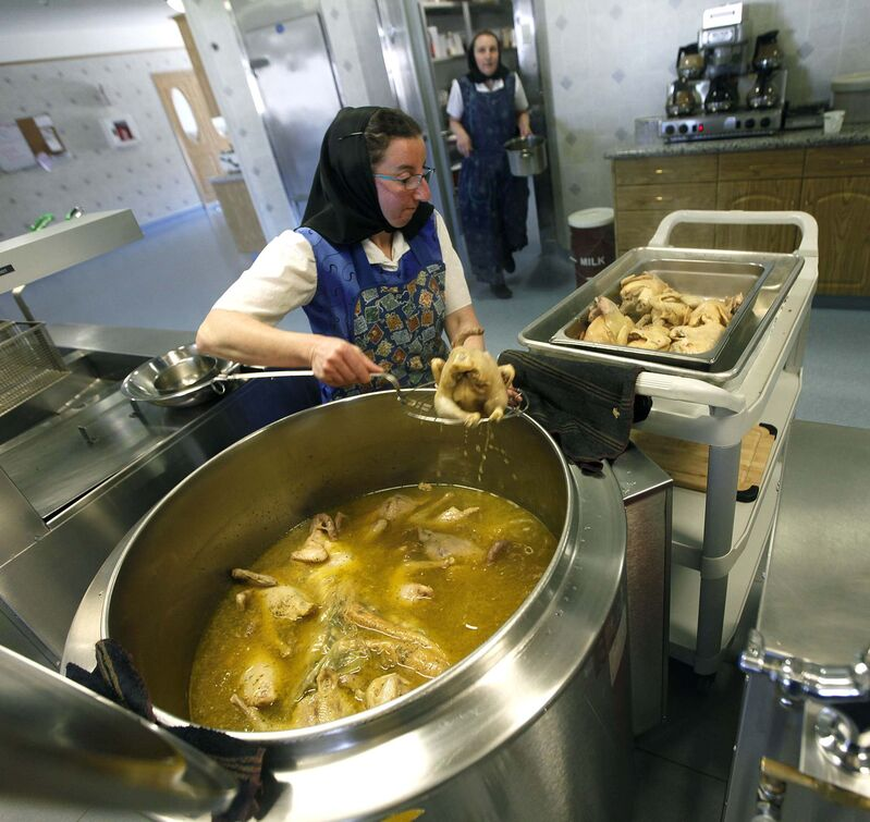PHIL HOSSACK/Winnipeg Free Press</p><p>Melissa Hofer removes cooked chicken from a huge soup pot at the James Valley Hutterite Colony community kitchen.</p>