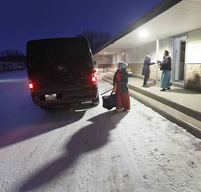 Team members load the van with gear at the Baker Community before heading to MacGregor for the annual charity game.  (Phil Hossack / Winnipeg Free Press)