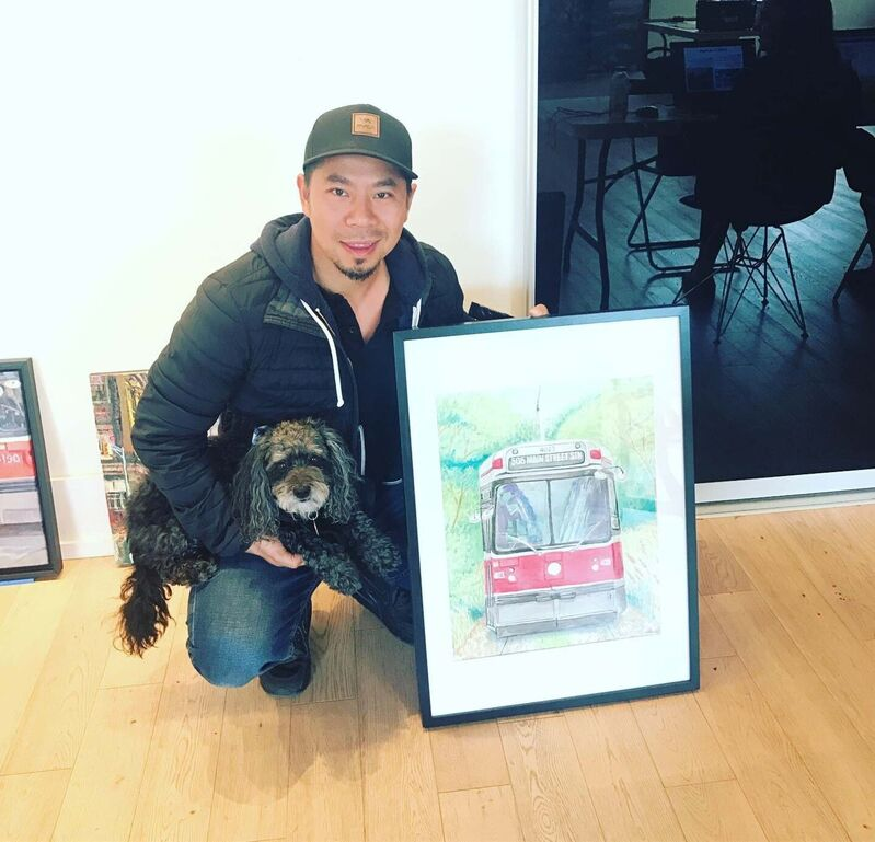 Mike Nguyen, with his dog Cookie, holds a painting of a TO streetcar.  (Supplied)