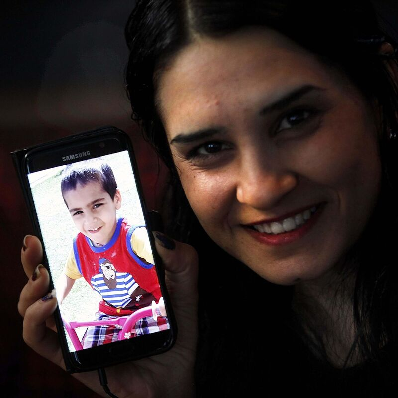 PHIL HOSSACK / WINNIPEG FREE PRESS  Not quick to smile, Mejo happily describes her young son Harman.