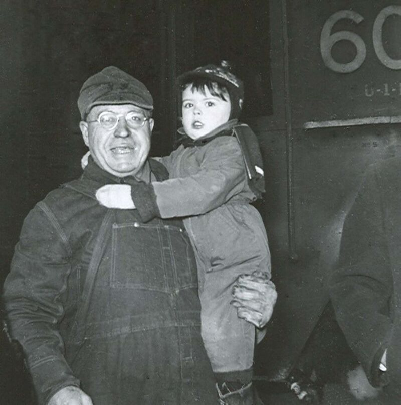 Paul Newsome</p><p>Paul Newsome's grandfather George holds him after he arrived from Redditt as the engineer on CN's Super Continental on March 31, 1954.</p></p>