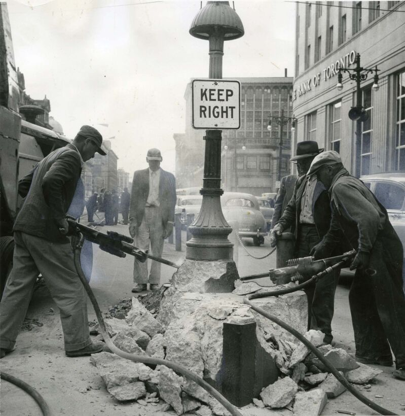 Workers clear Portage and Main of the safety islands along the streetcar tracks just hours after the last car passed in 1955. (Winnipeg Free Press Files)