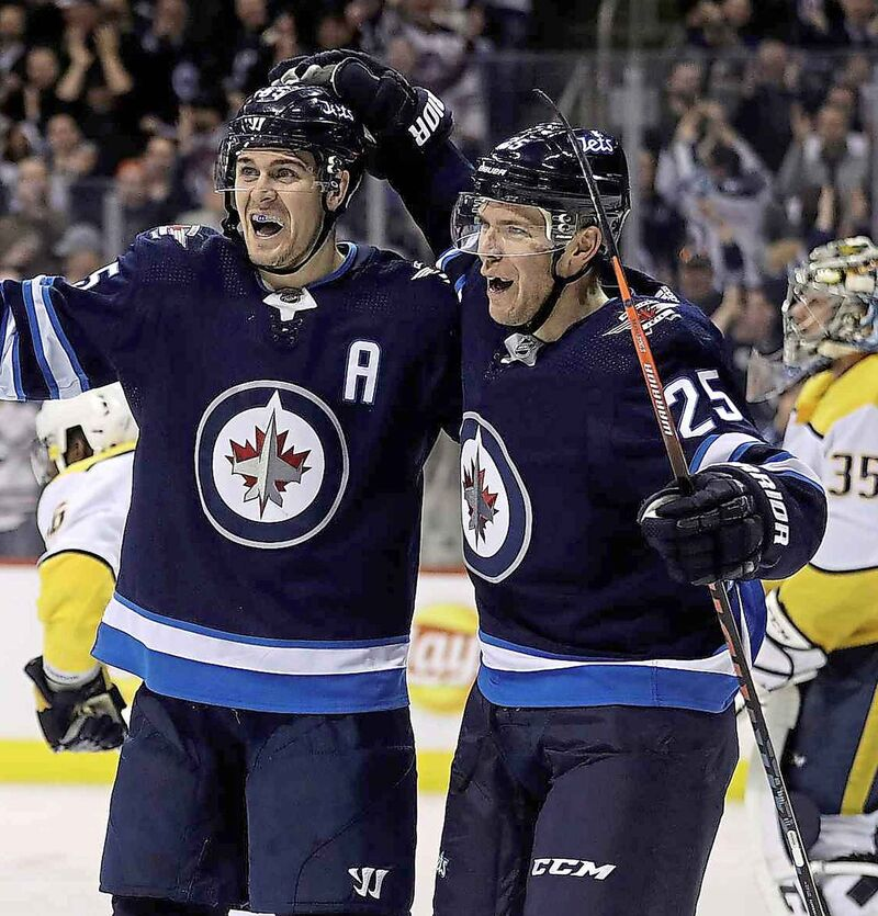 Mark Scheifele, left, and Paul Stastny celebrate a goal on Nashville Predators. Stastny signed a three-year, $19.5-million contract with the Vegas Golden Knights after his playoff run with the Jets was over.