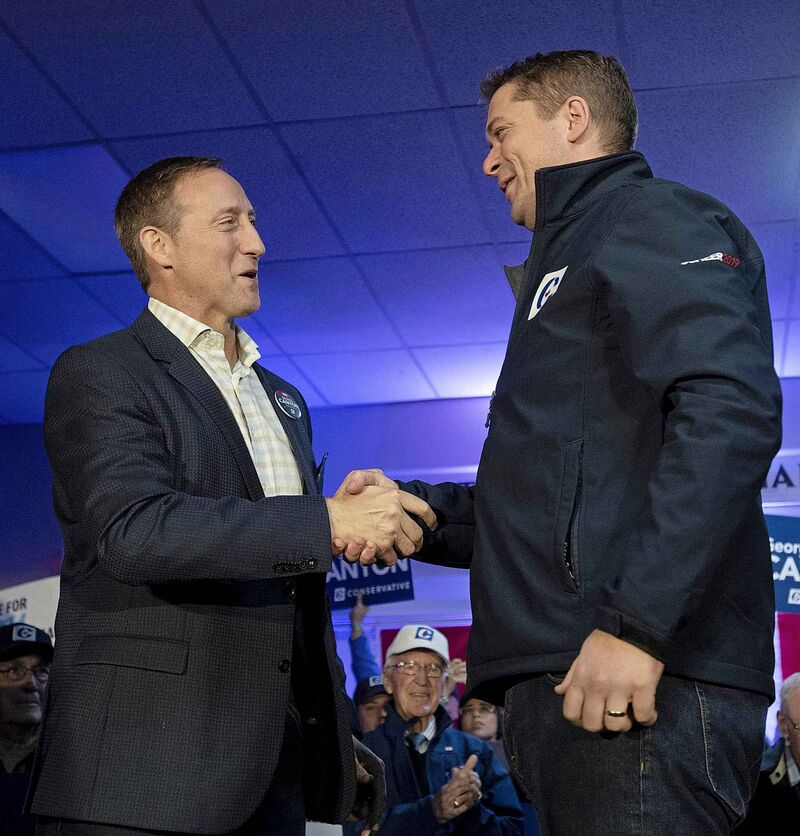 Peter MacKay (left) suggested Scheer's record on social issues, particularly abortion and LGBTTQ+ rights, allowed the Liberals to portray the Tories as intolerant. (Adrian Wyld / Canadian Press files)