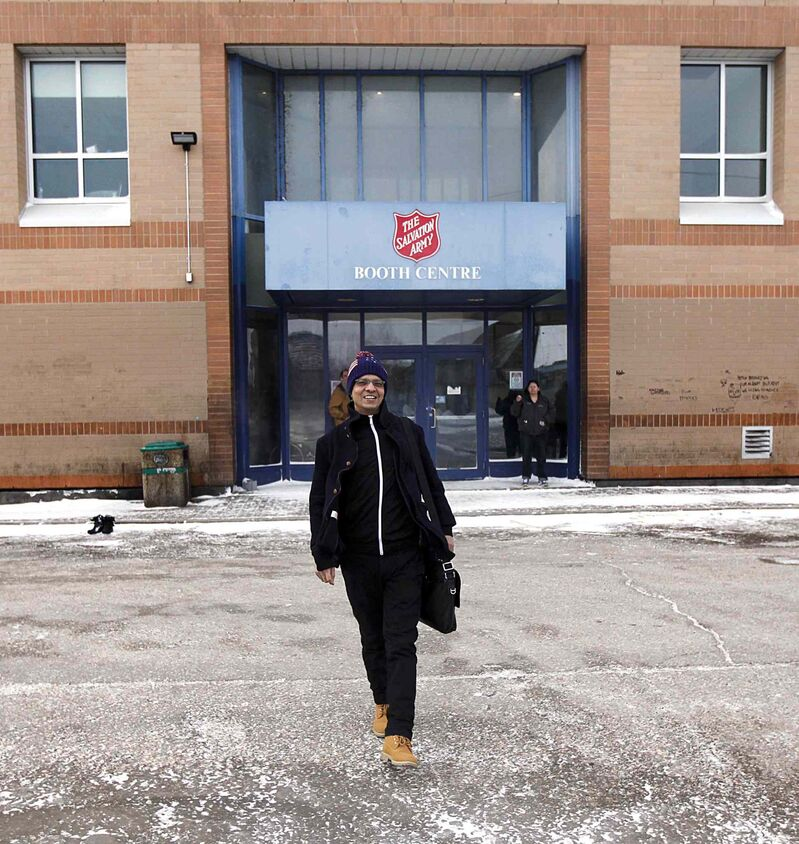 Shahadat Hossain walks out of the Salvation Army's Booth Centre Wednesday with a smile of relief on his face.