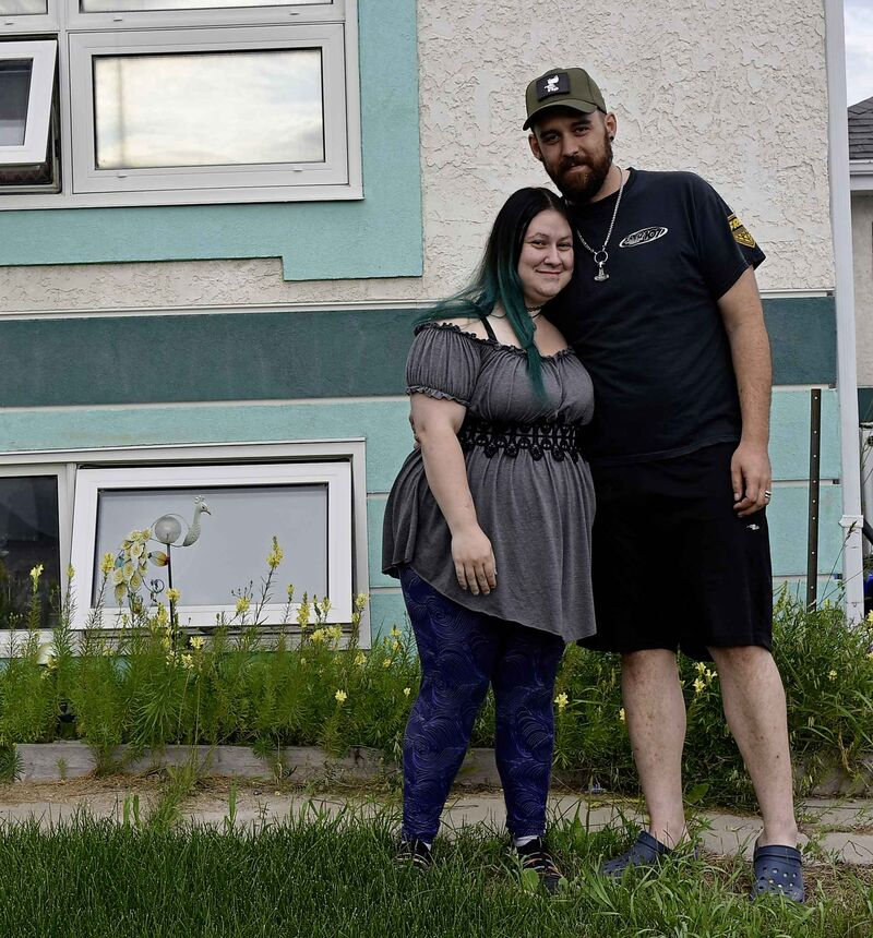 "Joel Atkinson, right, with wife Miranda in front of their home in Gillam: ""Normally you look for a bear when you step outside."""