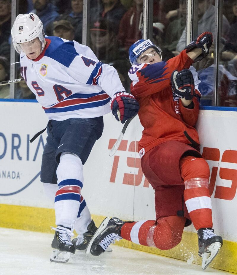 Dylan Samberg, left, while playing for the United States' at the IIHF world junior hockey tournament in January.