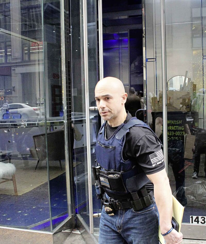 Law enforcement officials with the Federal Bureau of Investigation and the New York Police Department raid Nygard's headquarters in New York City last month.