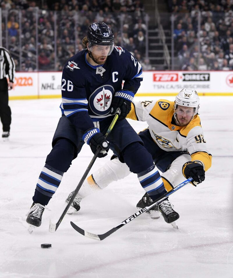 Blake Wheeler says it has been tough playing without his friend Dustin Byfuglien. (Fred Greenslade / The Canadian Press files)