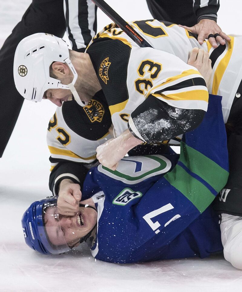Boston's Zdeno Chara punches Vancouver's Tyler Myers on Saturday. Chara won the fight, but Vancouver won the game 9-3. (Darryl Dyck / The Canadian Press files)</p>