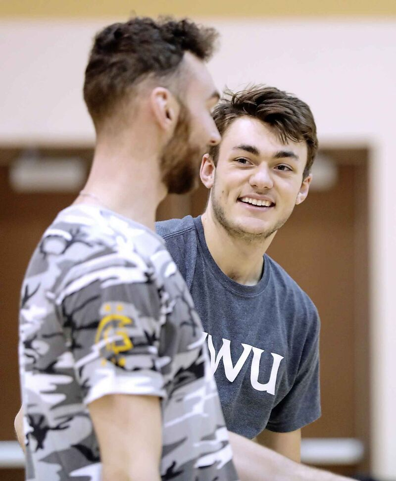 Trinity Western University men's volleyball player Eric Loeppky, right, is in his last season with the school and will be turning pro next season.