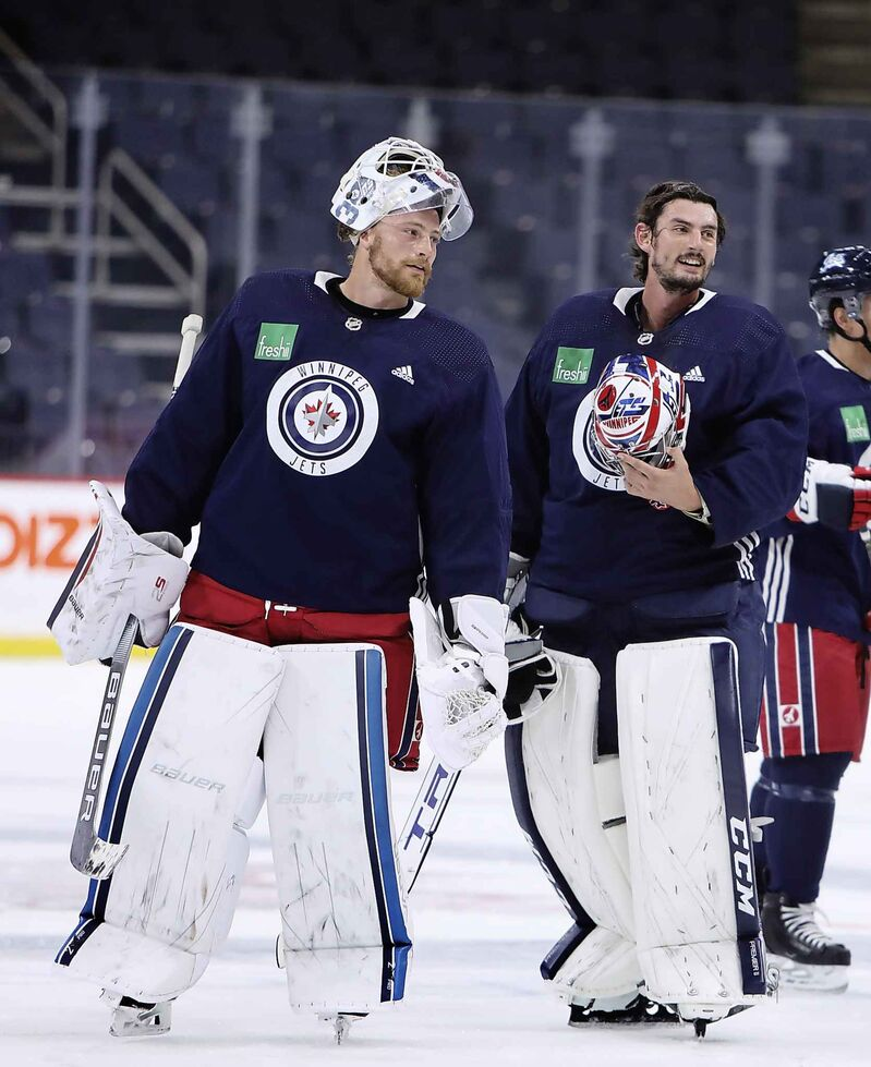 Jets goalies, Laurent Brossoit (left) and Connor Hellebuyck