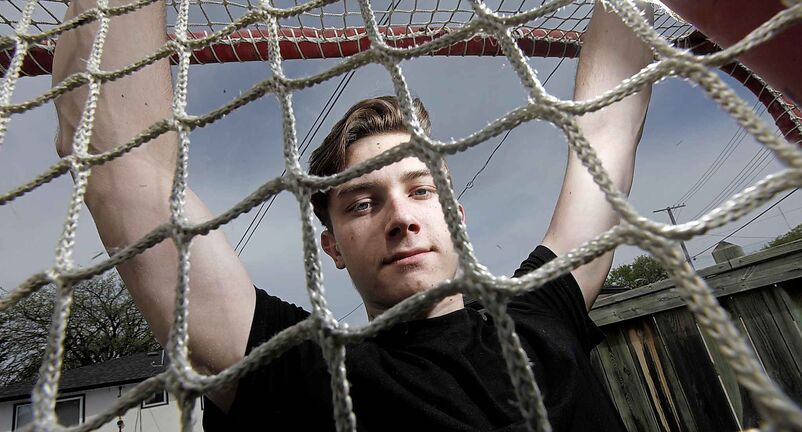 PHIL HOSSACK / WINNIPEG FREE PRESS  -  NHL draft prospect Cody Glass poses behind the mesh of a back yard hockey goal at his West Kildonan home Monday. See Mike Sawatzsky'sstory.  -  May 15, 2017