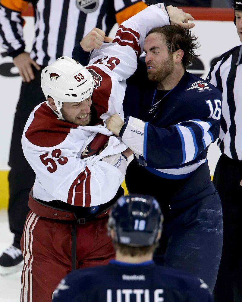 Coyotes Derek Morris fights Jets captain Andrew Ladd. (Trevor Hagan / The Canadian Press)