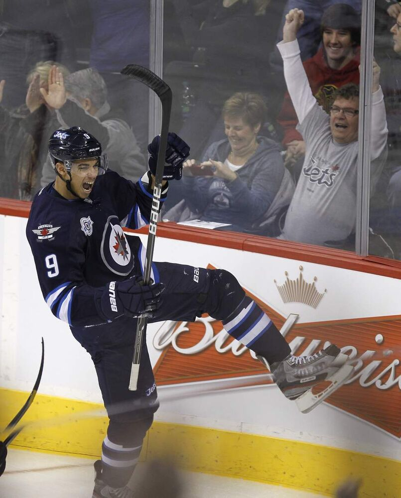 Winnipeg Jets' Evander Kane (9) scores the Jets opening goal as he deflects a puck past New Jersey Devils' goaltender Johan Hedberg during the opening period of play at MTS Centre, December 3rd, 2011. (TREVOR HAGAN/WINNIPEG FREE PRESS)