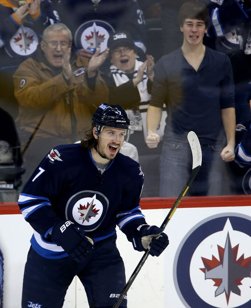 Winnipeg Jets' Keaton Ellerby (#7) celebrates after scoring against the Buffalo Sabres' during first period NHL hockey action in Winnipeg Tuesday.
