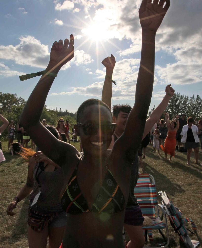 Towela Makanta has some fun dancing at the Winnipeg Folk Festival Main Stage Friday night. (Joe Bryksa / Winnipeg Free Press)