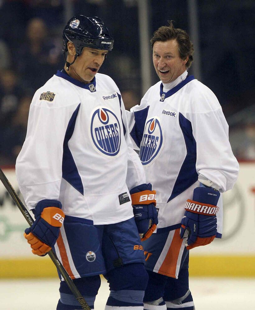 Edmonton Oilers alumni Wayne Gretzky, right, skates by  teammate Mark Messier. (JOE BRYKSA / WINNIPEG FREE PRESS) - JOE BRYKSA / WINNIPEG FREE PRESS