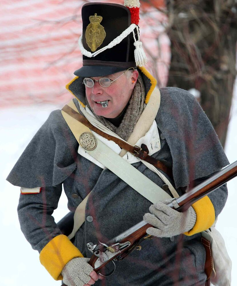 An actor in the historical reenactment between la Compagnie de La Verendrye and The Forces of Lord Selkirk at The Festival du Voyageur Sunday. (TREVOR HAGAN/WINNIPEG FREE PRESS)