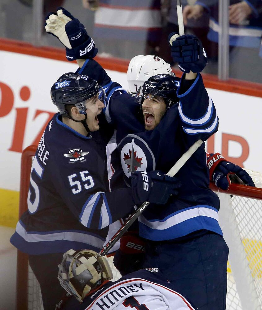Winnipeg Jets' Mark Scheifele (55) and Eric O'Dell (58) celebrate after O'Dell scored his first career NHL goal, during first period NHL hockey action against the Columbus Blue Jackets. (Trevor Hagan / Winnipeg Free Press)
