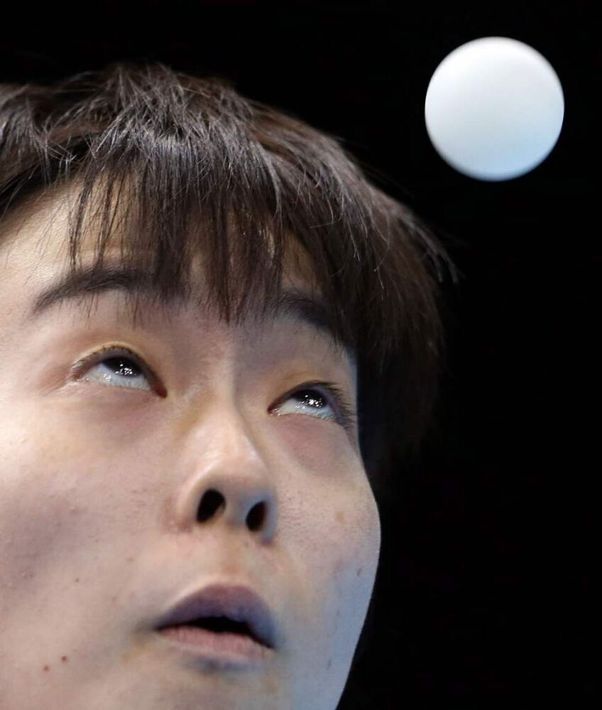 Kasumi Ishikawa of Japan competes against Yuegu Wang of Singapore during the women's singles table tennis competition at the 2012 Summer Olympics. (AP Photo/Sergei Grits)