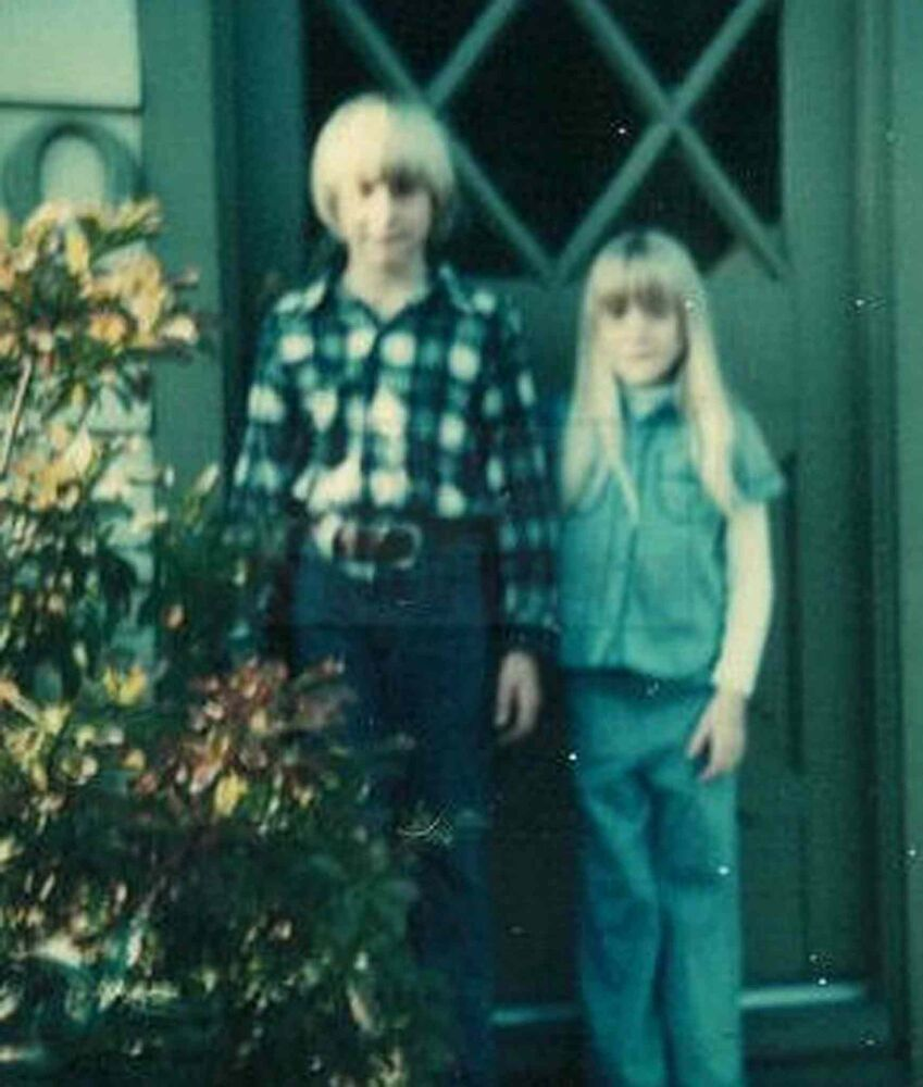 A young Kurt Cobain, left, and sister Kim outside their childhood home in Aberdeen, Wash.  (Kim Cobain)