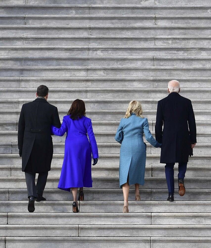 David Tulis / Pool Photo / The Associated Press<br>President-elect Joe Biden and his wife Jill, along with vice-president-elect Kamala Harris and her husband Douglas Emhoff, walk up the steps at the U.S. Capitol as they arrive ahead of Biden's inauguration, Wednesday.<br>