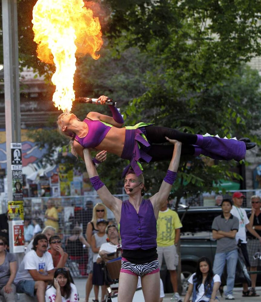 Terrebelle Murphy performs The Fire Breath of Death with partner Rusty Hammond. The entertainers are from Western Australia and were performing at Old Market Square for the Winnipeg Fringe festival. 