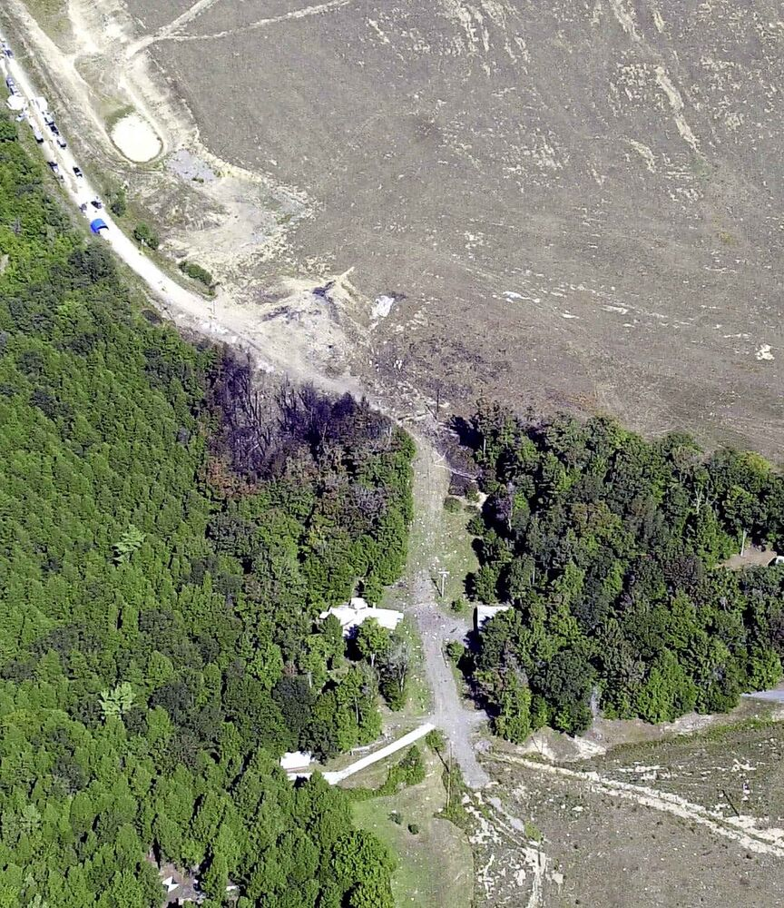 An FBI aerial photograph, taken Wednesday, Sept. 12, 2001, shows the crash site of hijacked United Airlines Flight 93 in Shanksville, Pa. The Boeing 757 was headed from Newark, N.J., to San Francisco when it made an abrupt turn near Cleveland and veered back east across Pennsylvania before crashing in Shanksville, killing all 44 aboard. Flight 93 was the fourth plane to crash in a coordinated terrorist attack that included New York's World Trade Center and the Pentagon, and the only one that didn't take lives on the ground. (AP Photo/FBI/FILE) -
