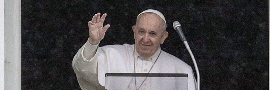 Pope Francis waves after reciting the Angelus prayer from his studio window overlooking St. Peter's Square, at the Vatican, Sunday, Feb. 7, 2021. (AP Photo/Gregorio Borgia)