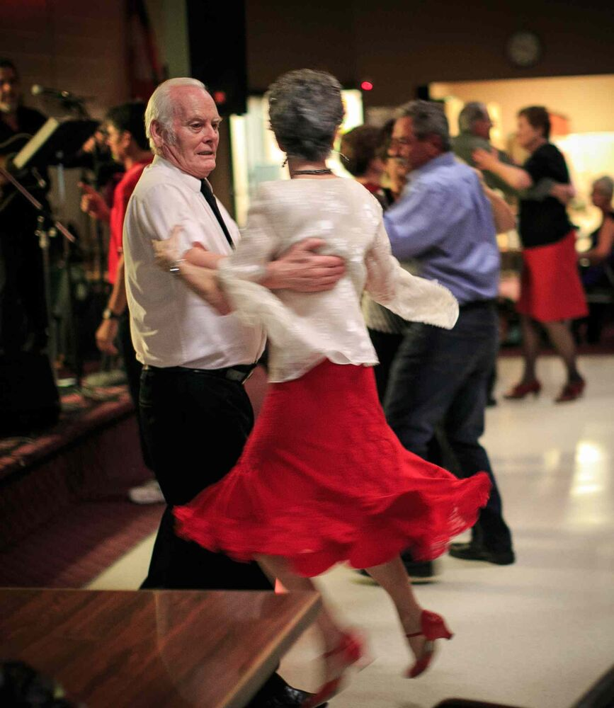 Lillian Wright (in red skirt) and partner Ken Palen dance at the Norwood St. Boniface Legion weekly Saturday Night Dance.