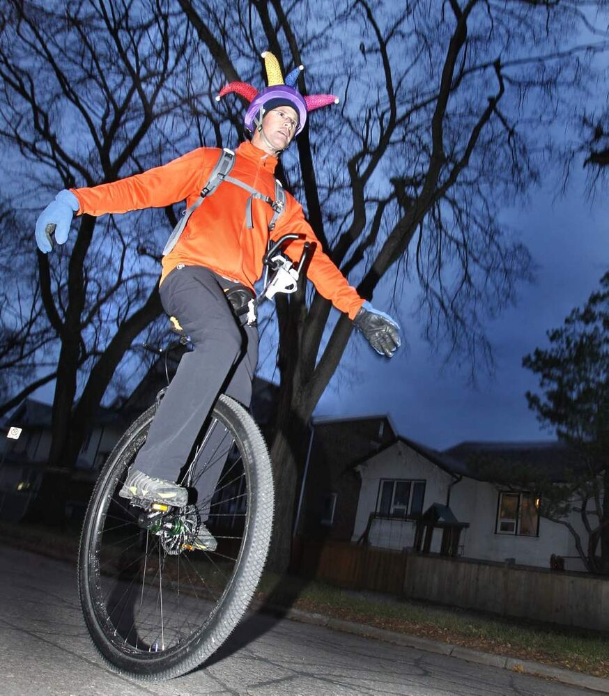 Keith Holm, a year-round unicyclist and teacher at Daniel McIntyre High School, heads to school down Alverstone Street on his 8.8 kilometre ride from home. Thursday, October 25, 2012. (WAYNE GLOWACKI / WINNIPEG FREE PRESS)