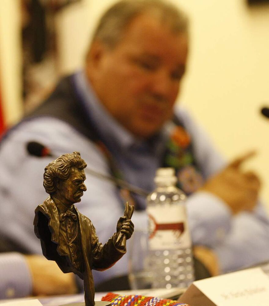 With the bronze image of Louis Riel in the foreground, Manitoba Metis Federation President David Chartrand introduces his Land Claims Strategic Investment Committee. July 31 2013