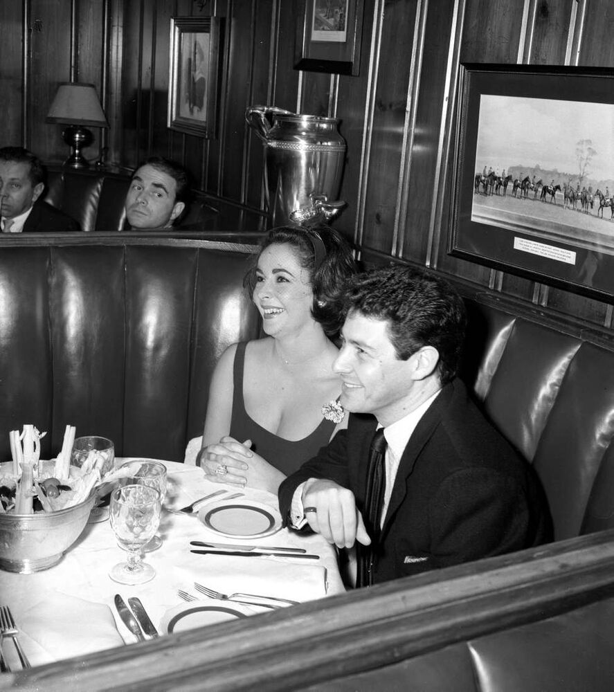 Actress Elizabeth Taylor and singer Eddie Fisher dine out at Chasen's restaurant in Los Angeles, California, in January 1959.  (Los Angeles Times/MCT)