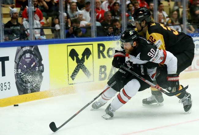 Germany's Oliver Mebus, right, challenges for the puck with Canada's Ryan O'Reilly, left, during the Ice Hockey World Championships group B match between Canada and Germany at the Jyske Bank Boxen arena in Herning, Denmark, Tuesday, May 15, 2018. (AP Photo/Petr David Josek)