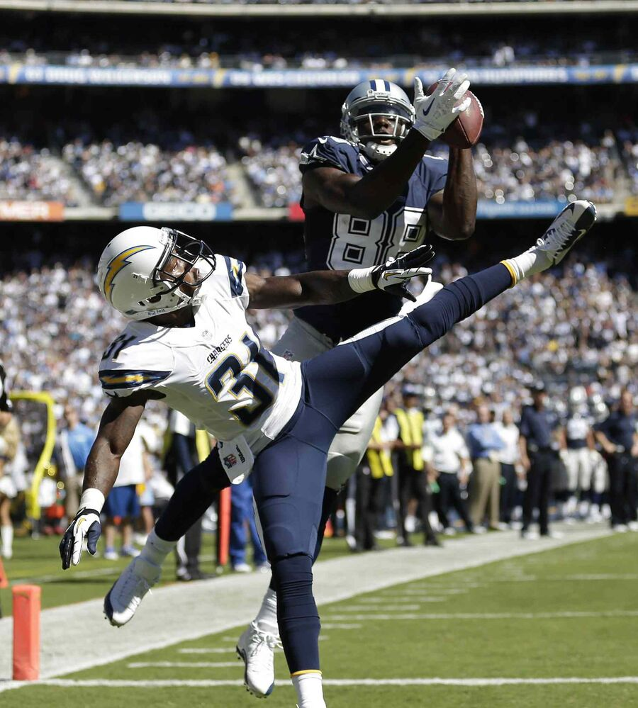 Dallas Cowboys wide receiver Dez Bryant catches a touchdown pass against San Diego Chargers defensive back Richard Marshall during the Chargers 30-21 win, Sunday in San Diego. (Gregory Bull / The Associated Press)