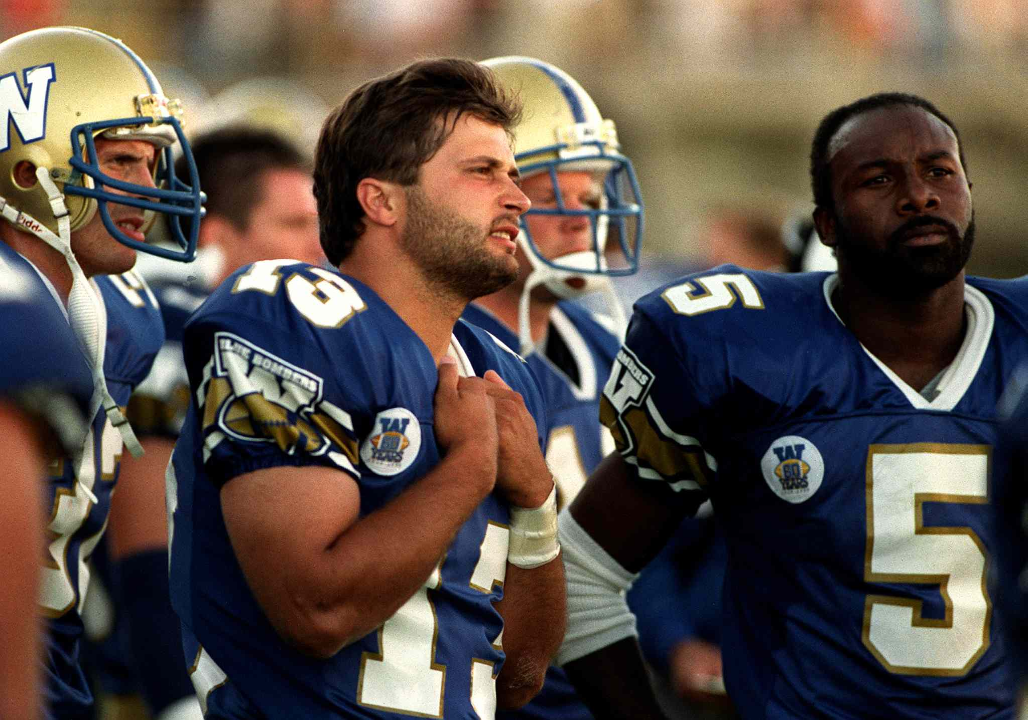 Blue Bomber QB Tom Burgess and RB Tim Jessie  in pre-season game. Burgess played two seasons (1990-91) and won a Grey Cup  with the Bombers.