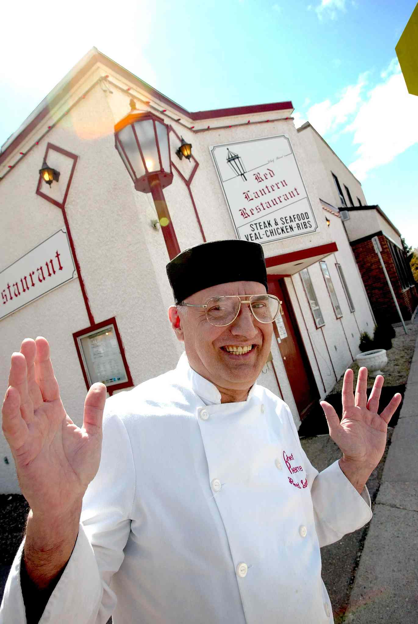 Red Lantern owner and chef Pierre Molin stands in front of the restaurant in 2002. (Jeff de Booy / Winnipeg Free Press files)