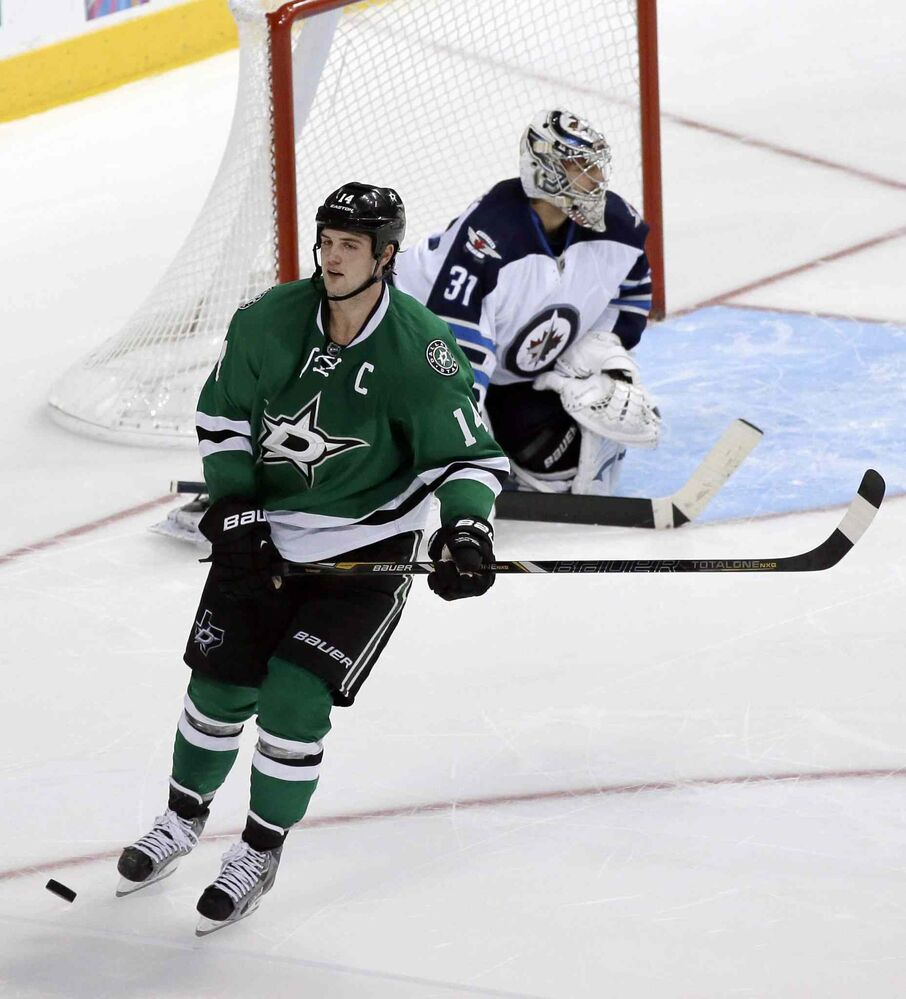 Dallas Stars captain Jamie Benn skates away after his shootout attempt against Ondrej Pavelec hit the post. (The Associated Press)