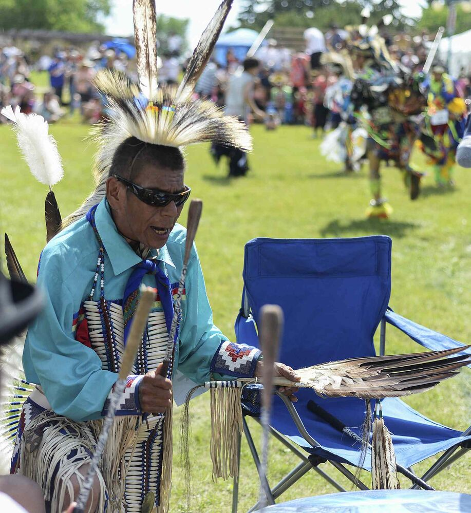 Chuck Spence sings and plays the drums while dancers perform at the National Aboriginal Day celebration at The Forks.  (Sarah Taylor / Winnipeg Free Press)