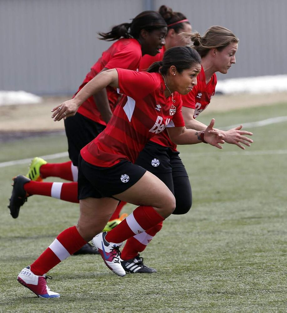 Winnipeg's  Desiree Scott  and teammates do sprints  during   practice. Team Canada woman's soccer team practices at the Winnipeg Soccer Complex in preparation for their game vs Team USA. May 5, 2014 (KEN GIGLIOTTI / WINNIPEG FREE PRESS)